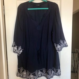 Blue tunic with white embroidery